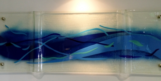 Coloured fused glass panel