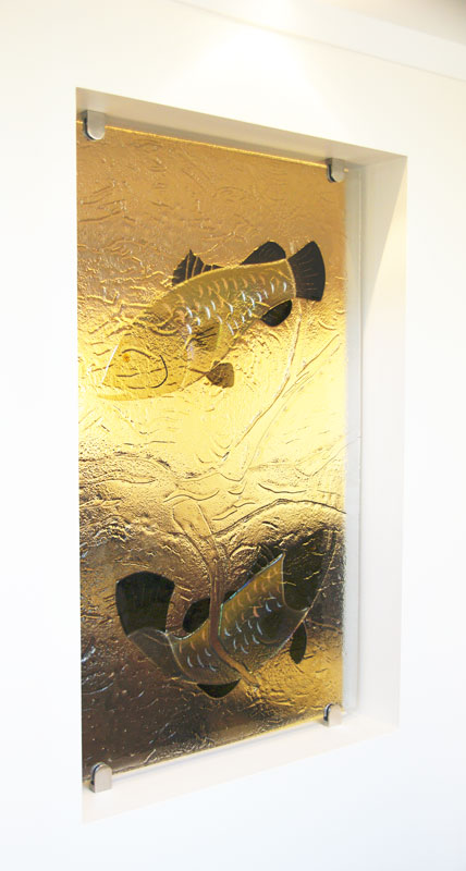 Decorative glass partition featuring fish