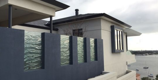 Slumped glass privacy fence