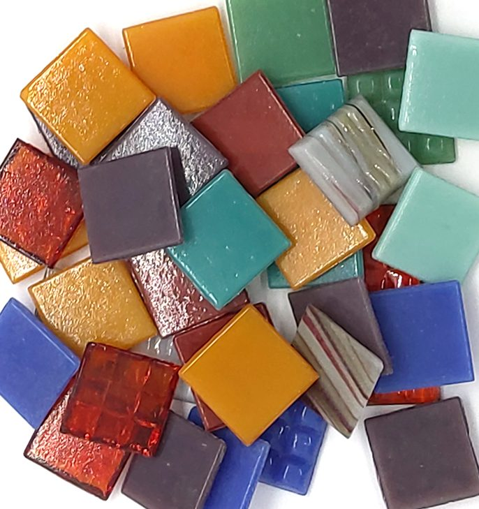 pile of various coloured 20mm glass mosaic with flat finish tiles