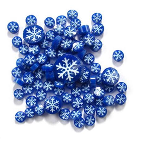 pile of millefiori snowflake dark blue and white on white background