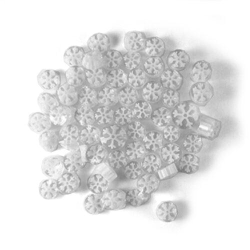 pile of millefiori white snowflakes pattern on white background