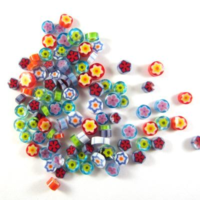 pile of millefiori assorted floral pattern on white background