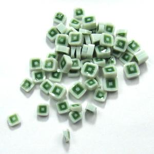 pile of millefiori green and white squares on white background