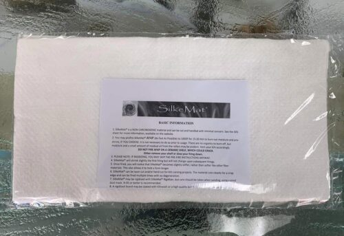 packaged silkemat with folder instructions