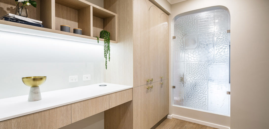 feature glass panel in pale wood panelled scullery
